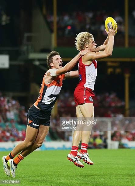 Isaac Heeney of the Swans takes a mark under pressure from Aidan Corr of the Giants during the round three AFL match between the Sydney Swans and the...