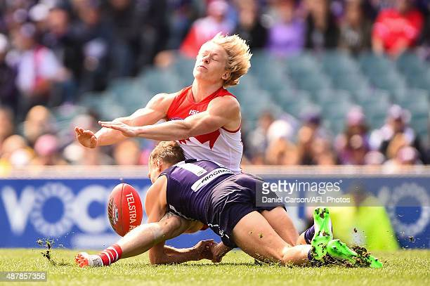 Isaac Heeney of the Sydney Swans has his legs taken by Tom Sheridan of the Fremantle Dockers during the 2015 AFL First Qualifying Final match between...