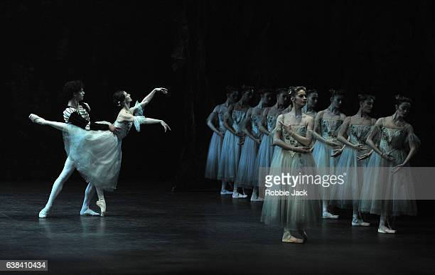 Isaac Hernandez as Albrecht Alina Cojocaru as Giselle and Laurretta Summerscales as Myrtha with artists of the company in English National Ballet's...