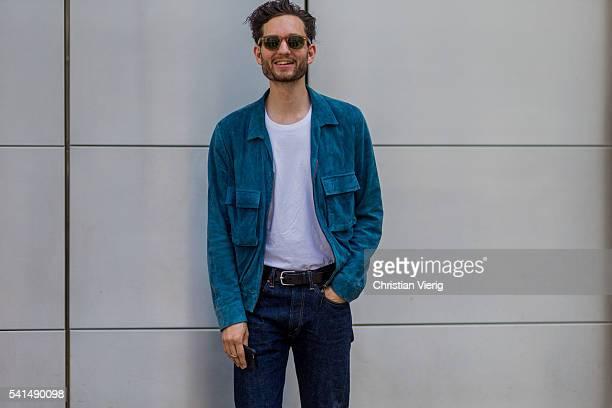 Isaac HindinMiller wearing navy denim jeans outside Ferragamo during the Milan Men's Fashion Week Spring/Summer 2017 on June 19 2016 in Milan Italy