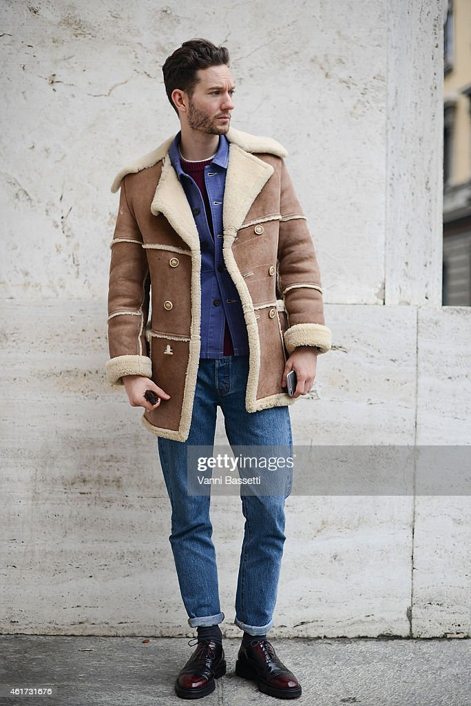 Isaac Hirdin-Miller poses wearing a vintage coat and Levi's pants during day 2 of Milan Menswear Fashion Week Fall/Winter 2015/2016 on January 18, 2015 in Milan, Italy.