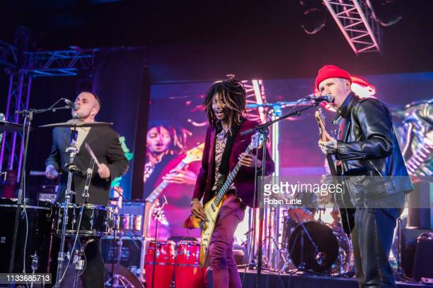 Isaac Holman of Slaves Seye Adelekan of Gorillaz and Laurie Vincent of Slaves perform on stage in Africa Express The Circus part of Waltham Forest...