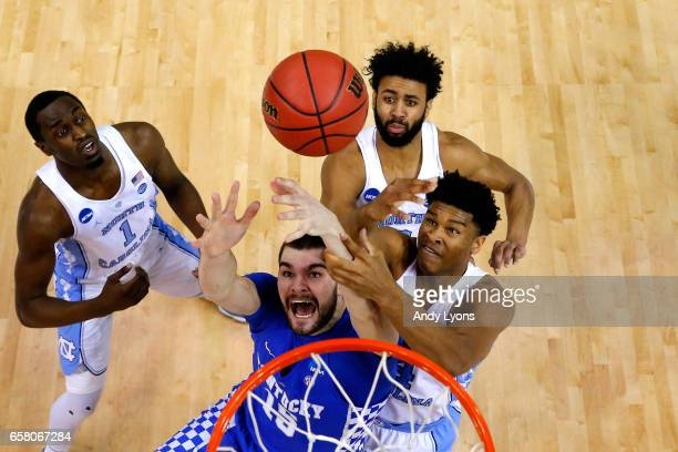 Isaac Humphries of the Kentucky Wildcats competes for a rebound with Theo Pinson Isaiah Hicks and Joel Berry II of the North Carolina Tar Heels in...