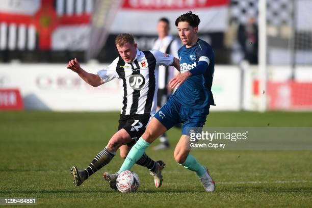 Isaac Hutchinson of Derby County battles for possession with Will Tomlinson of Chorley FC during the FA Cup Third Round match between Chorley and...