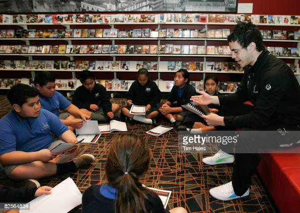 Isaac John of the Junior Warriors talks with school children during the Rugby League Reads programme at Auckland Central Library on August 27 2008 in...