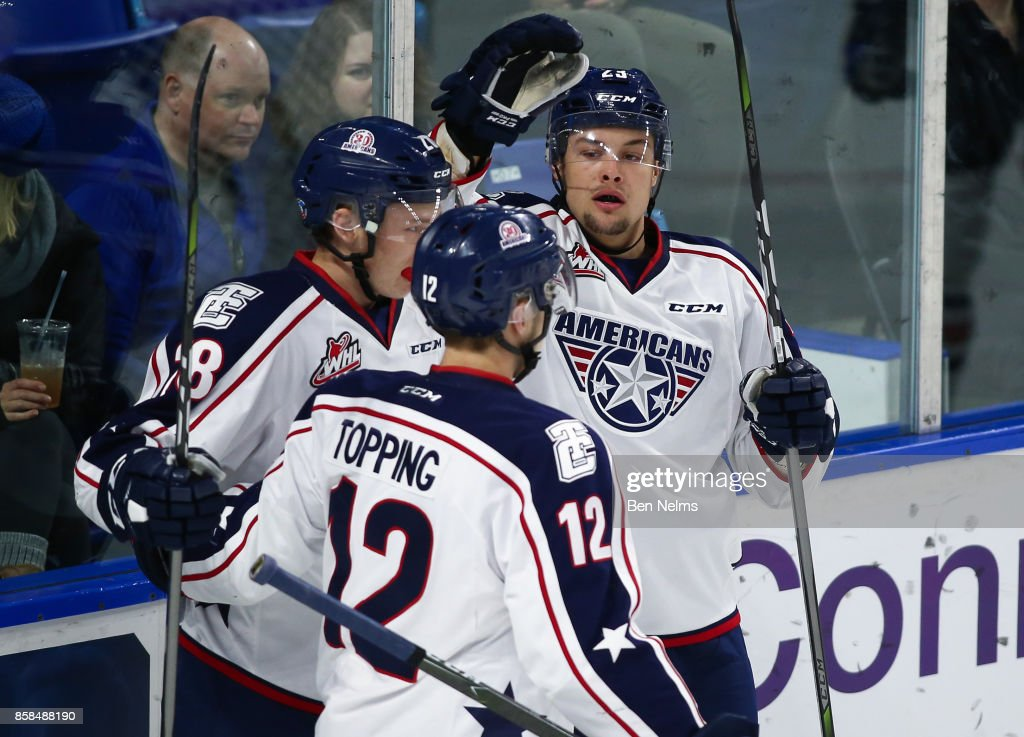Isaac Johnson #23 of the Tri-City Americans celebrates his goal against the Vancouver Giants with teammates Morgan Geekie #28 and Jordan Topping #12 during the first period of their WHL game at the Langley Events Centre on October 6, 2017 in Langley, British Columbia, Canada.