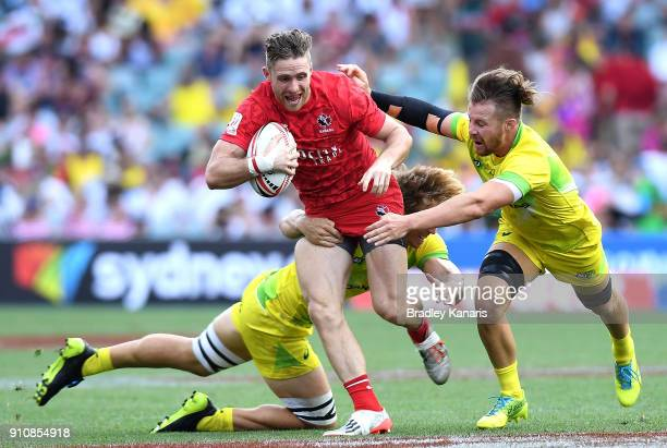 Isaac Kaay of Canada attempts to break through the defence in the match against Australia during day two of the 2018 Sydney Sevens at Allianz Stadium...