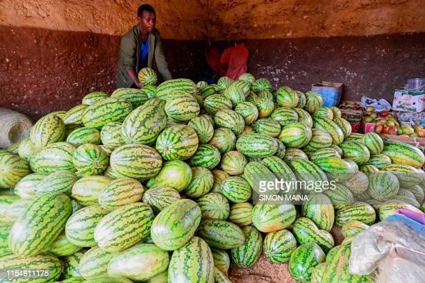 Isaac kango a fruit vendor sorts watermelon at his shop on July 8 2019 in Kiambu