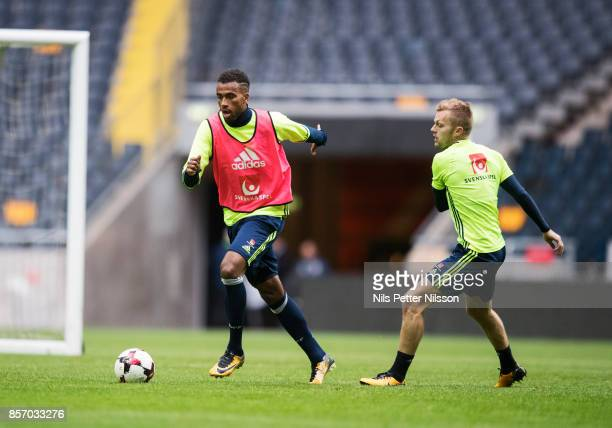 Isaac Kiese Thelin and Sebastian Larsson of Sweden during the FIFA 2018 World Cup Qualifier between Sweden and Luxembourg at Friends arena on October...