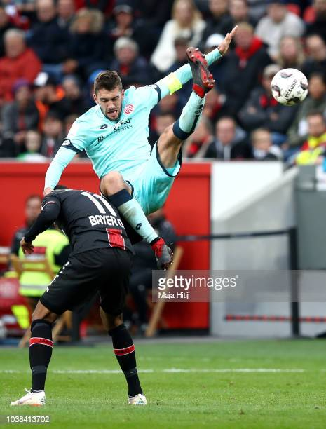 Isaac Kiese Thelin of Bayer 04 Leverkusen battles for possession with Stefan Bell of FSV Mainz during the Bundesliga match between Bayer 04...