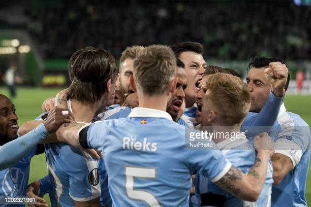 Isaac Kiese Thelin of Malmö celebrates scoring the first goal with teammates during the UEFA Europa League, last 32, first leg football match VfL...