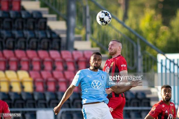 Isaac Kiese Thelin of Malmo FF and Thomas Isherwood of Ostersunds FK during the Allsvenskan match between Ostersunds FK and Malmo FF at Jamtkraft...