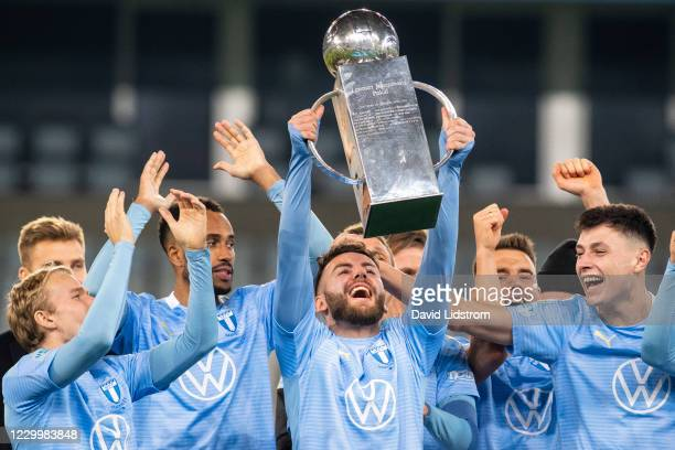 Isaac Kiese Thelin of Malmo FF, Erdal Rakip of Malmo FF, Anel Ahmedhodzic of Malmo FF and players of Malmo FF celebrates the first place in...