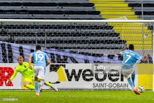 Isaac Kiese Thelin of Malmo FF scores the 2-2 goal from the penalty spot during an Allsvenskan match between AIK and Malmo FF at Friends Arena on...