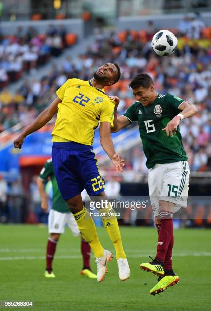 Isaac Kiese Thelin of Sweden vies with Hector Moreno of Mexico during the 2018 FIFA World Cup Russia group F match between Mexico and Sweden at...