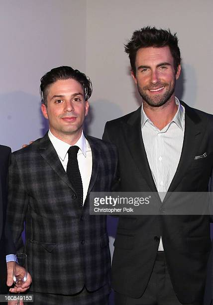 Isaac Lekach and musician Adam Levine attends the Adam Levine launch of his signature fragrances at The Premier Fragrance Installation on February 6...