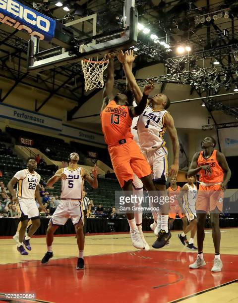 Isaac Likekele of the Oklahoma State Cowboys attempts a shot against Ja'vonte Smart of the LSU Tigers during the game at HP Field House on November...