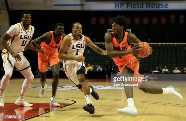 Isaac Likekele of the Oklahoma State Cowboys is defended by Ja'vonte Smart of the LSU Tigers during the game at HP Field House on November 25 2018 in...