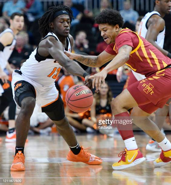 Isaac Likekele of the Oklahoma State Cowboys steals the ball from Prentiss Nixon of the Iowa State Cyclones in the first half during the first round...