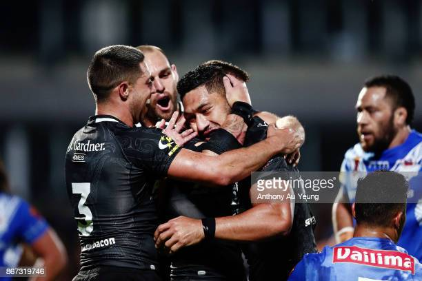 Isaac Liu of the Kiwis celebrates with teammates after scoring a try during the 2017 Rugby League World Cup match between the New Zealand Kiwis and...
