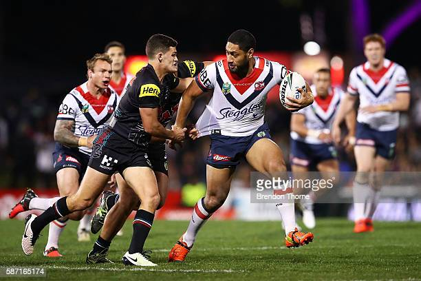 Isaac Liu of the Roosters breaks the Panthers defence during the round 22 NRL match between the Penrith Panthers and the Sydney Roosters at Pepper...