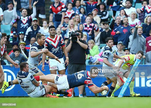 Isaac Liu of the Roosters dives to score during the round 23 NRL match between the Sydney Roosters and the North Queensland Cowboys at Allianz...
