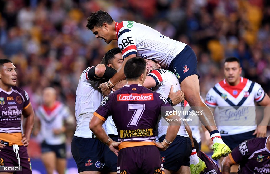Isaac Liu of the Roosters is congratulated by team mates after scoring a try during the round 11 NRL match between the Brisbane Broncos and the Sydney Roosters at Suncorp Stadium on May 18, 2018 in Brisbane, Australia.