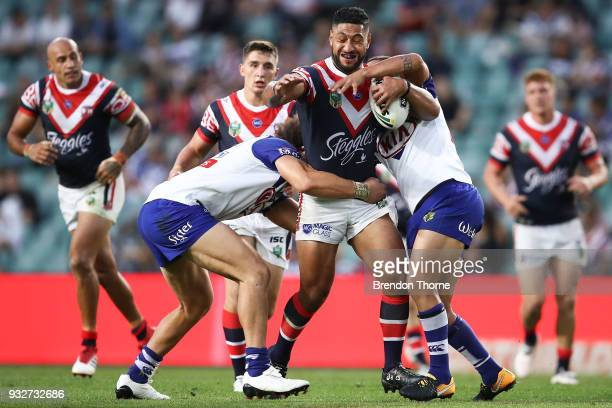 Isaac Liu of the Roosters is tackled by the Bulldogs defence during the round two NRL match between the Sydney Roosters and the Canterbury Bulldogs...