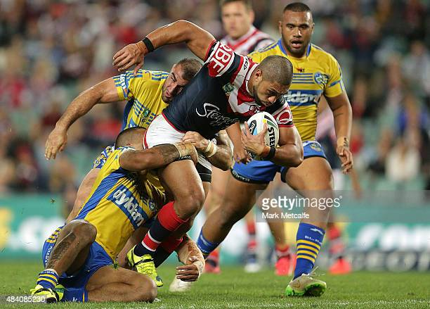 Isaac Liu of the Roosters is tackled by Tim Mannah of the Eels during the round 23 NRL match between the Sydney Roosters and the Parramatta Eels at...