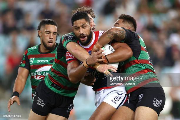 Isaac Liu of the Roosters is tackled during the round three NRL match between the South Sydney Rabbitohs and the Sydney Roosters at Stadium Australia...