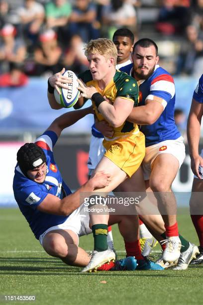 Isaac Lucas of Australia U20 is tackled by Theo Lachaud and Jean Baptiste Gros of France U20 during the final match of World Rugby U20 Championship...