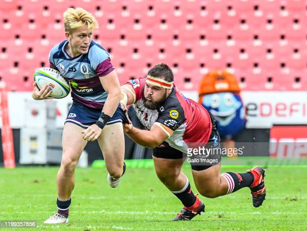 Isaac Lucas of the Reds tackled during the Super Rugby match between Emirates Lions and Reds at Emirates Airline Park on February 08, 2020 in...