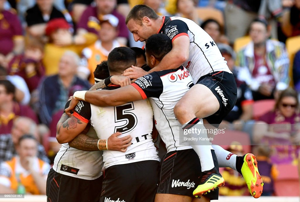 Isaac Luke of the Warriors is congratulated by team mates after scoring a try during the round 18 NRL match between the Brisbane Broncos and the New Zealand Warriors at Suncorp Stadium on July 15, 2018 in Brisbane, Australia.