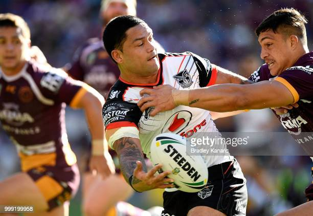 Isaac Luke of the Warriors offloads during the round 18 NRL match between the Brisbane Broncos and the New Zealand Warriors at Suncorp Stadium on...
