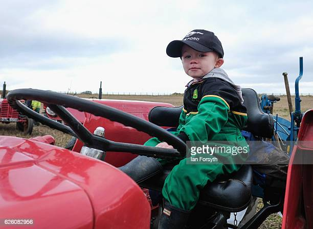Isaac Lumley from Ugthorpe sits on a tractor during the annual ploughing match on November 27, 2016 in Staithes, United Kingdom. The event which is...