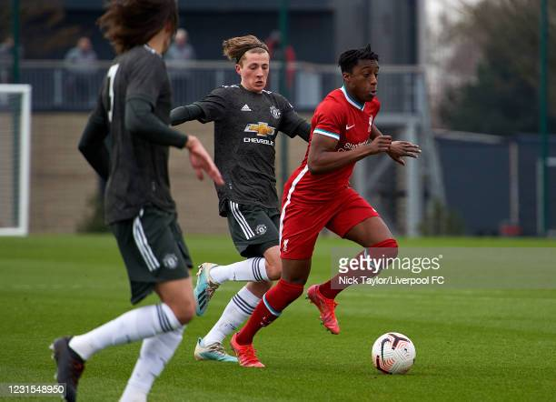 Isaac Mabaya of Liverpool and Charlie Savage of Manchester United in action during the U18 Premier League game between Liverpool and Manchester...