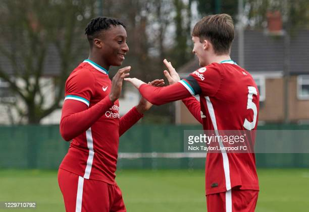 Isaac Mabaya of Liverpool celebrates scoring Liverpool's fourth goal with team mate Terrence McLaughlin Miles at Melwood Training Ground on November...