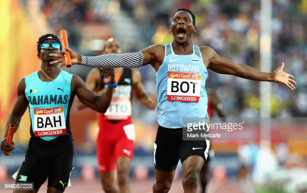 Isaac Makwala of Botswana celebrates as he crosses the line to win gold in the Men's 4x400 metres relay final during athletics on day 10 of the Gold...
