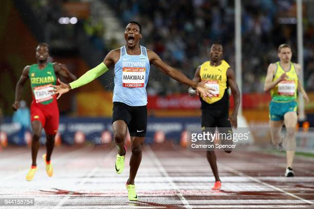 Isaac Makwala of Botswana celebrates as he races to the line to win gold in the Men's 400 metres final during the Athletics on day six of the Gold...