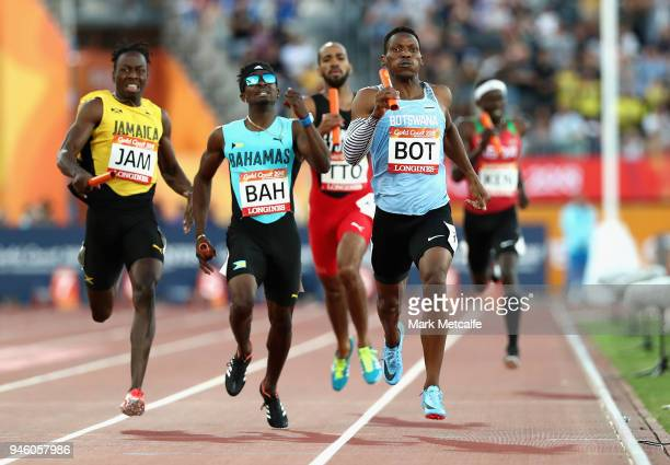 Isaac Makwala of Botswana races to the line to win gold ahead of Alonzo Russell of the Bahamas and Javon Francis of Jamaica of in the Men's 4x400...