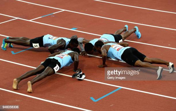 Isaac Makwala Onkabetse Nkobolo Baboloki Thebe and Leaname Maotoanong of Botswana perform push ups as they celebrate winning gold in the Men's 4x400...
