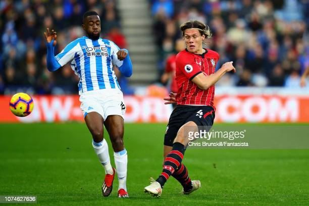 Isaac Mbenza of Huddersfield Town and Jannik Vestergaard of Southampton FC in action during the Premier League match between Huddersfield Town and...