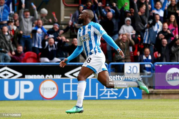Isaac Mbenza of Huddersfield Town celebrates as he scores his team's first goal during the Premier League match between Huddersfield Town and...