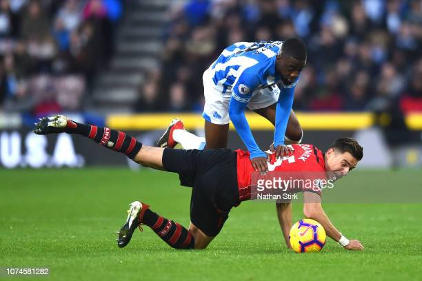 Isaac Mbenza of Huddersfield Town is challenged by Jan Bednarek of Southampton during the Premier League match between Huddersfield Town and...