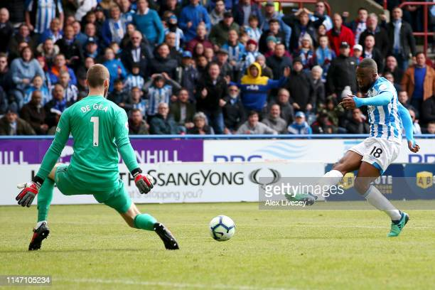 Isaac Mbenza of Huddersfield Town scores his team's first goal past David De Gea of Manchester United during the Premier League match between...