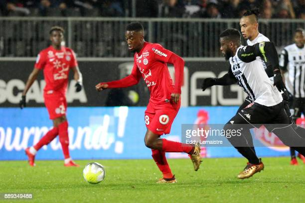 Isaac Mbenza of Montpellier and Ismael Traore of Angers during the Ligue 1 match between Angers SCO and Montpellier Herault SC at Stade Raymond Kopa...