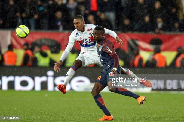 Isaac Mbenza of Montpellier and Marcelo Guedes of Lyon during the Ligue 1 match between Montpellier Herault SC and Olympique Lyonnais at Stade de la...