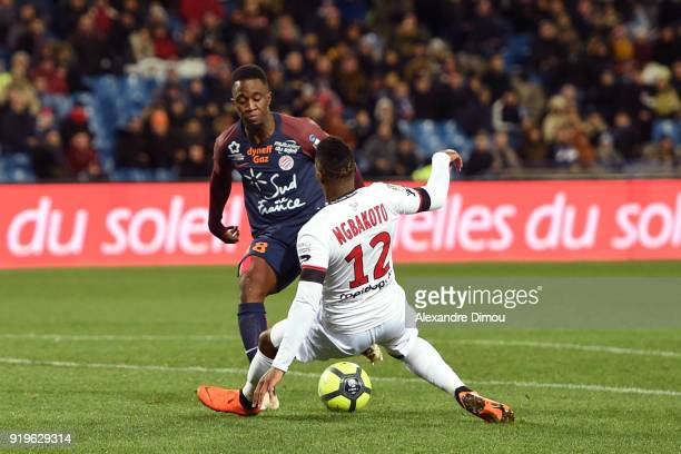 Isaac Mbenza of Montpellier and Yeni Ngbakoto of Guinguamp during the Ligue 1 match between Montpellier Herault SC and EA Guingamp at Stade de la...
