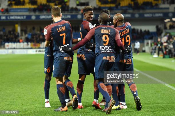 Isaac Mbenza of Montpellier celebrates scoring with teammates during the Ligue 1 match between Montpellier and Angers at Stade de la Mosson on...