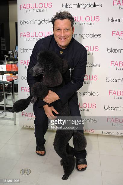 Isaac Mizrahi poses with Starr at the launch of his first fragrance FABULOUS Isaac Mizrahi at Bloomingdale's 59th Street Store on October 18 2012 in...